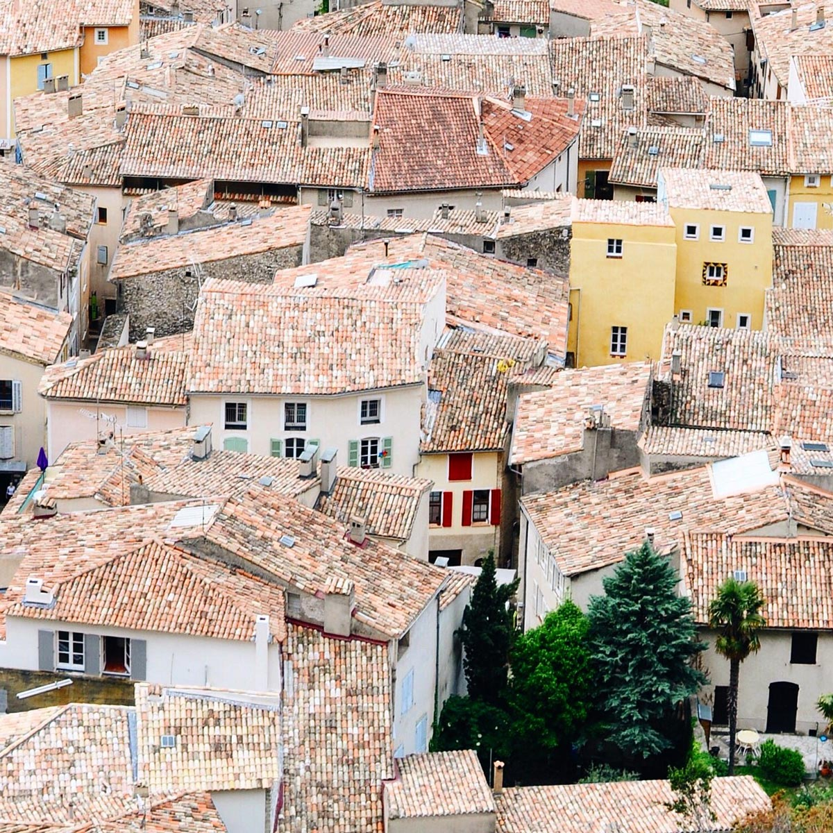 Photo by Lauren Wells of rooftops in Moustiers-Saint-Marie, France shot from roof of a building