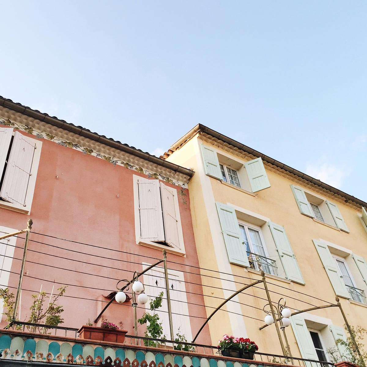 Photo by Lauren Wells of colorful french homes with window shutters