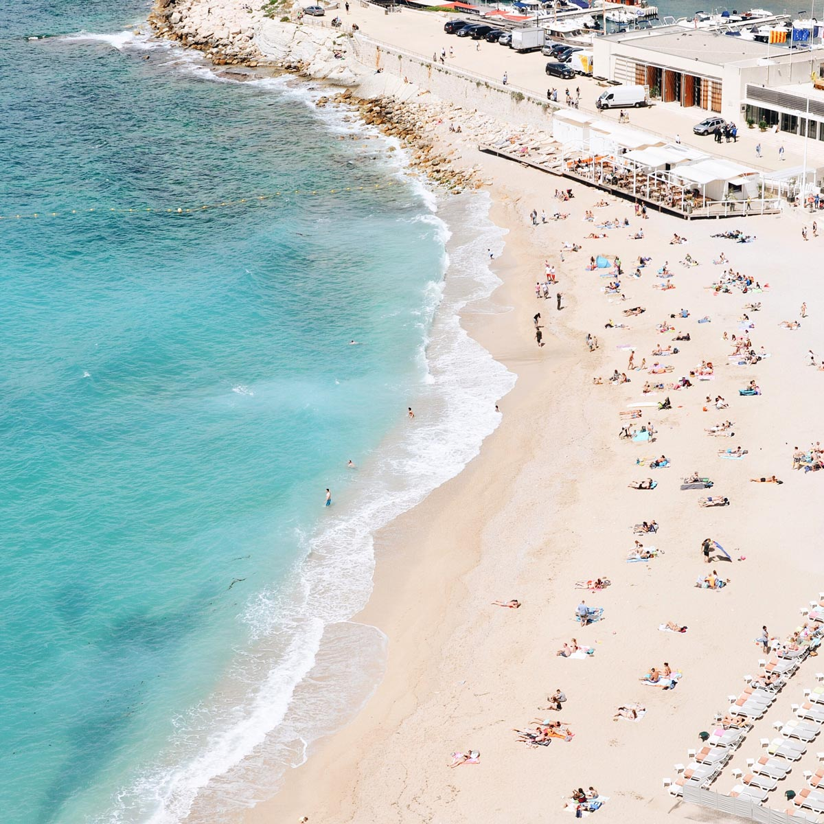 Overhead photo by Lauren Wells of busy beach in Cassis, France