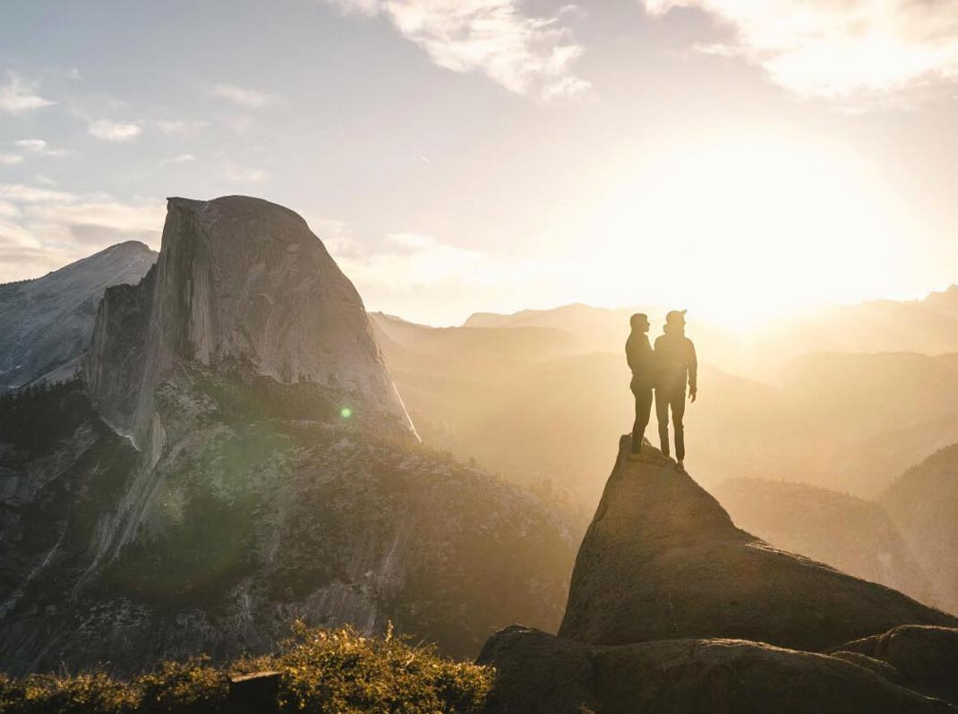 Photo by Joel Bear of couple at sunrise in Yosemite