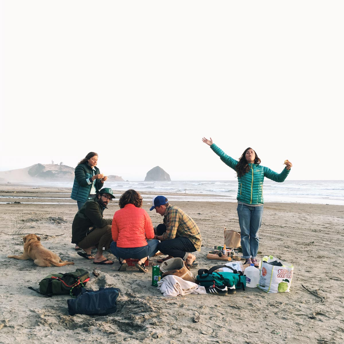 Photo by Jules Davis of campers cooking on the coastline