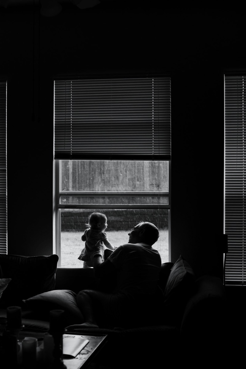 Inkedfingers photo in black and white of man and little girl at window