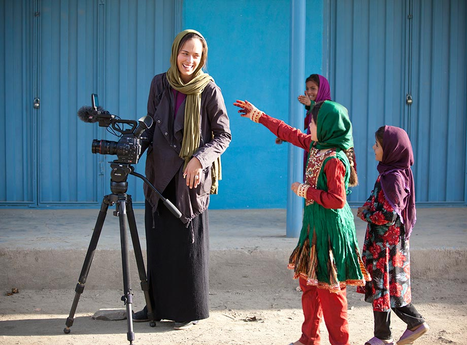 Little girls run up to a photograpgher in Afghanistan