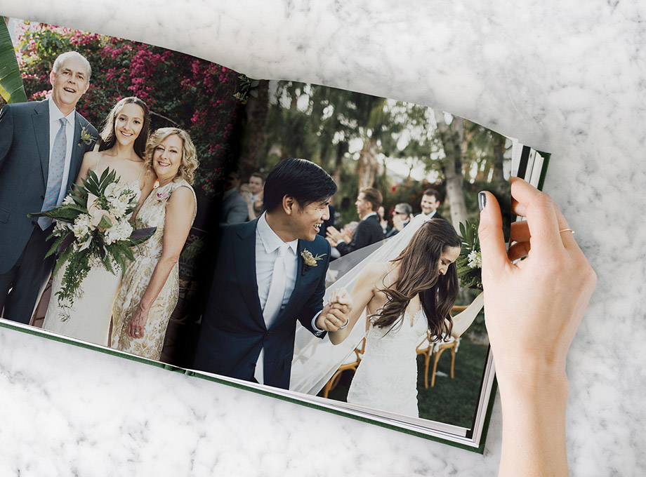 Layflat wedding album opened to side by side wedding photos