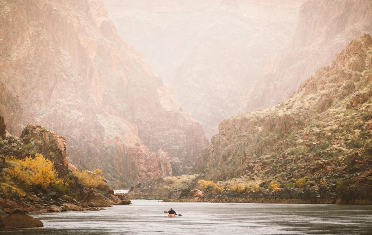 Man canoeing in empty river