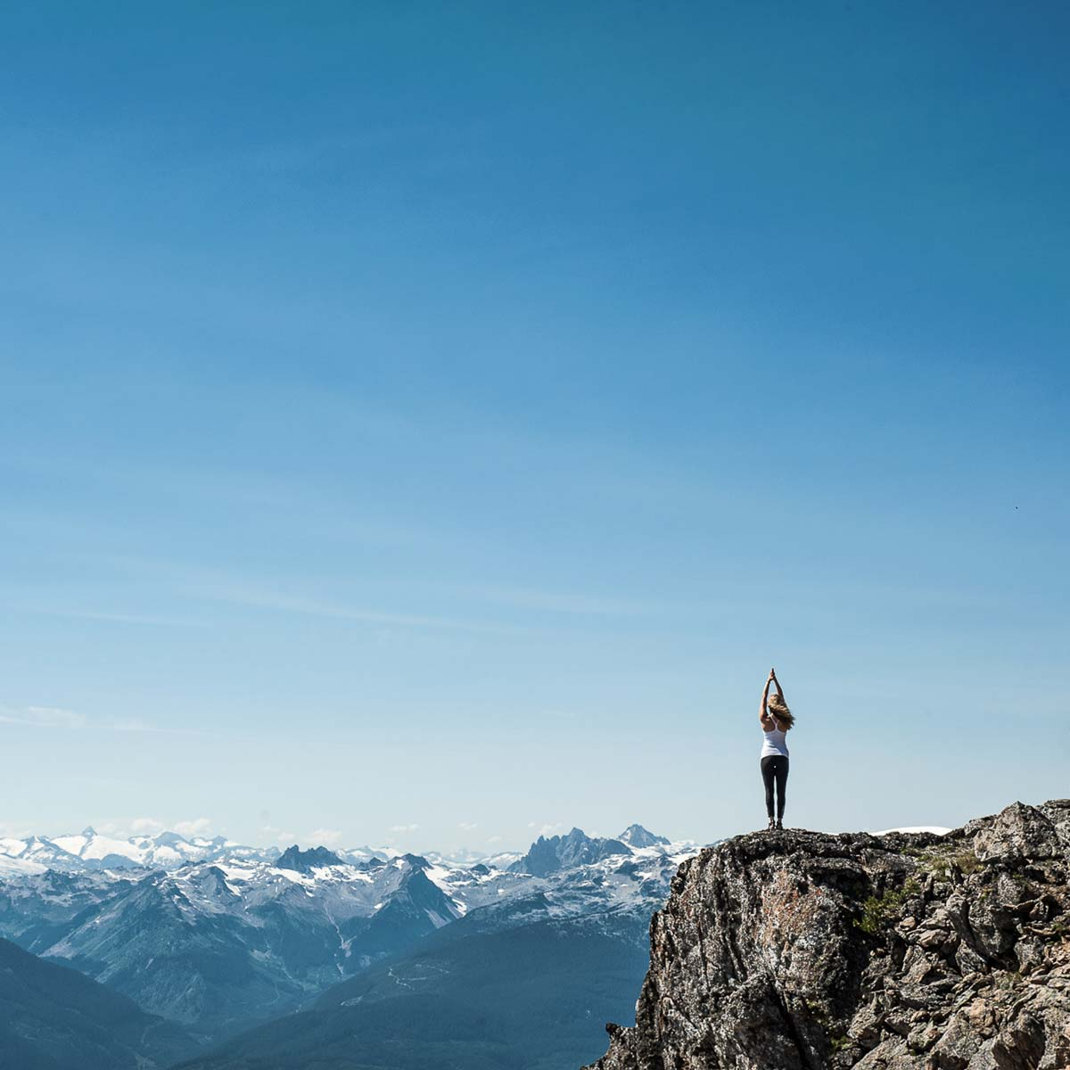 Woman standing on a rock in Whistler, Canada