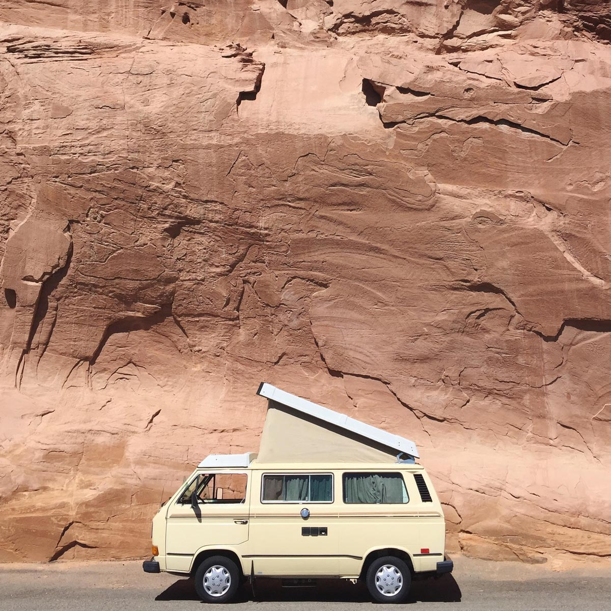 Old van on the side of a rocky highway