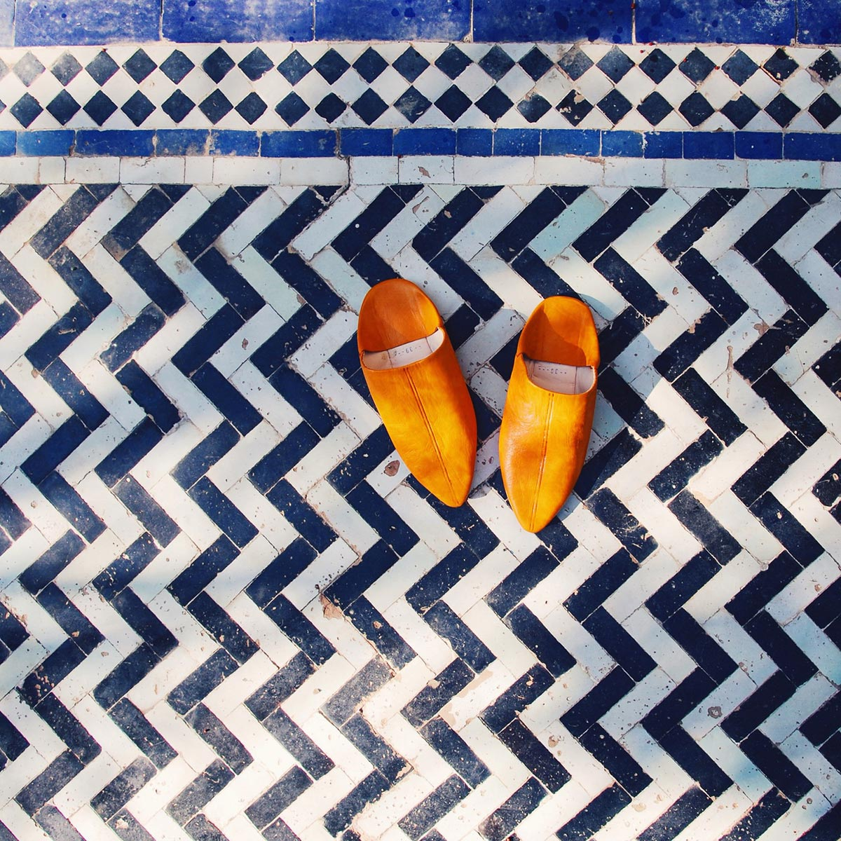 Orange shoes on textured tile