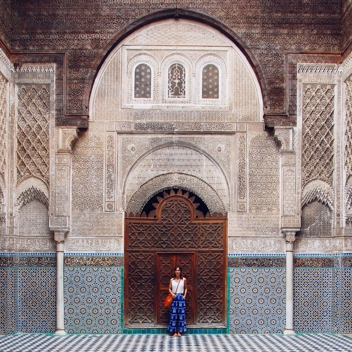 Woman posing in front of a door