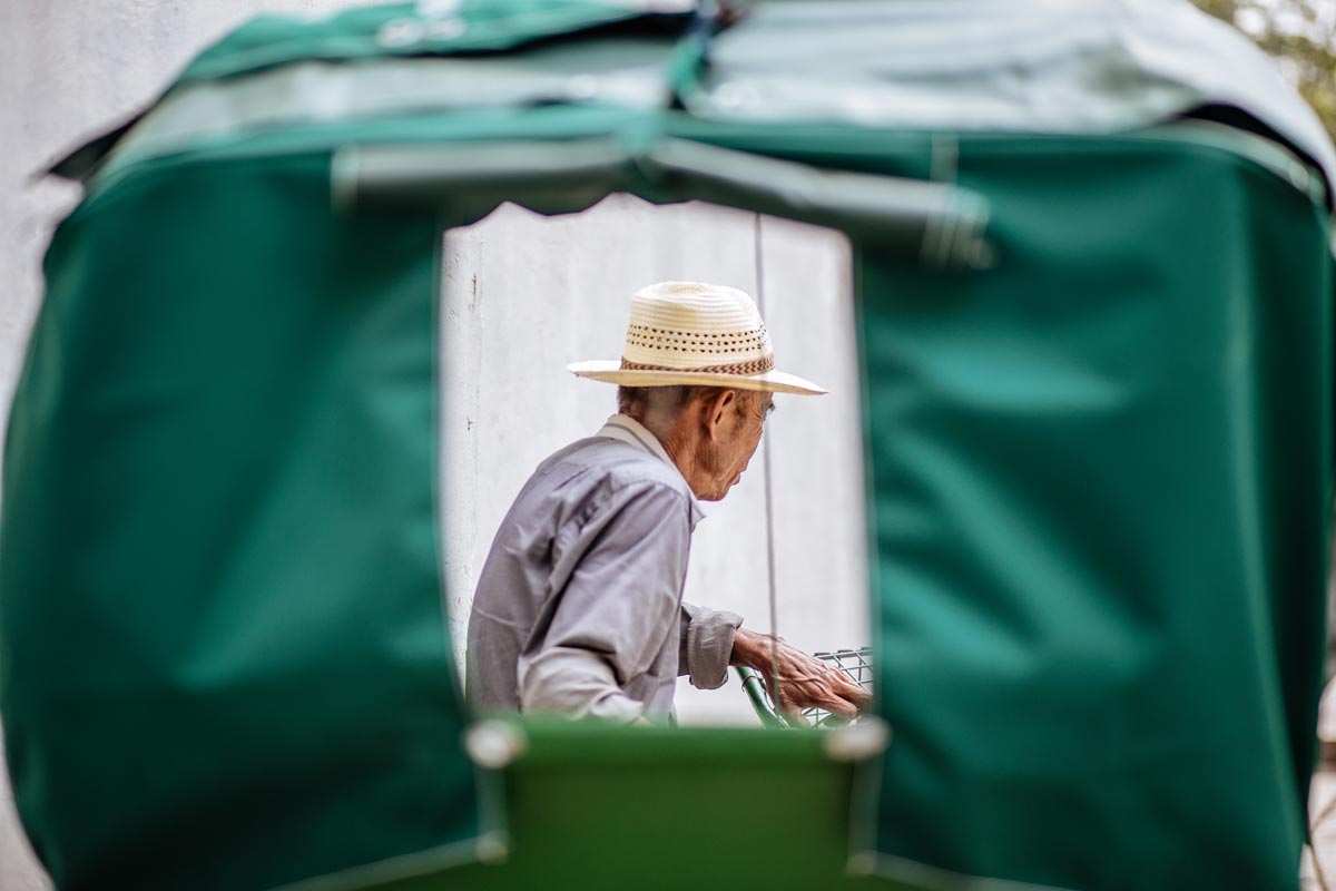 View through an open tent of an older gentleman