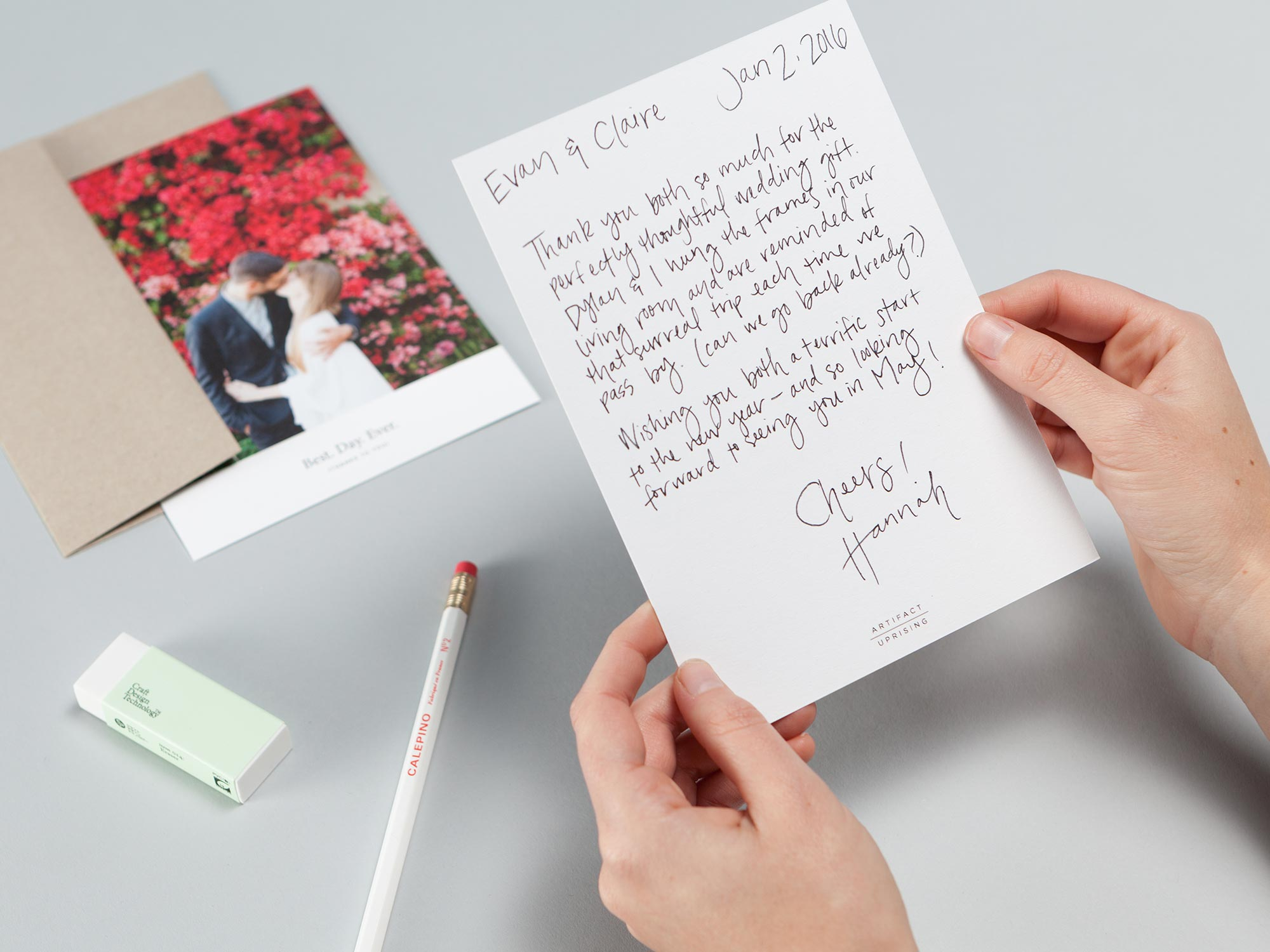 A photo card with hand written note on the back