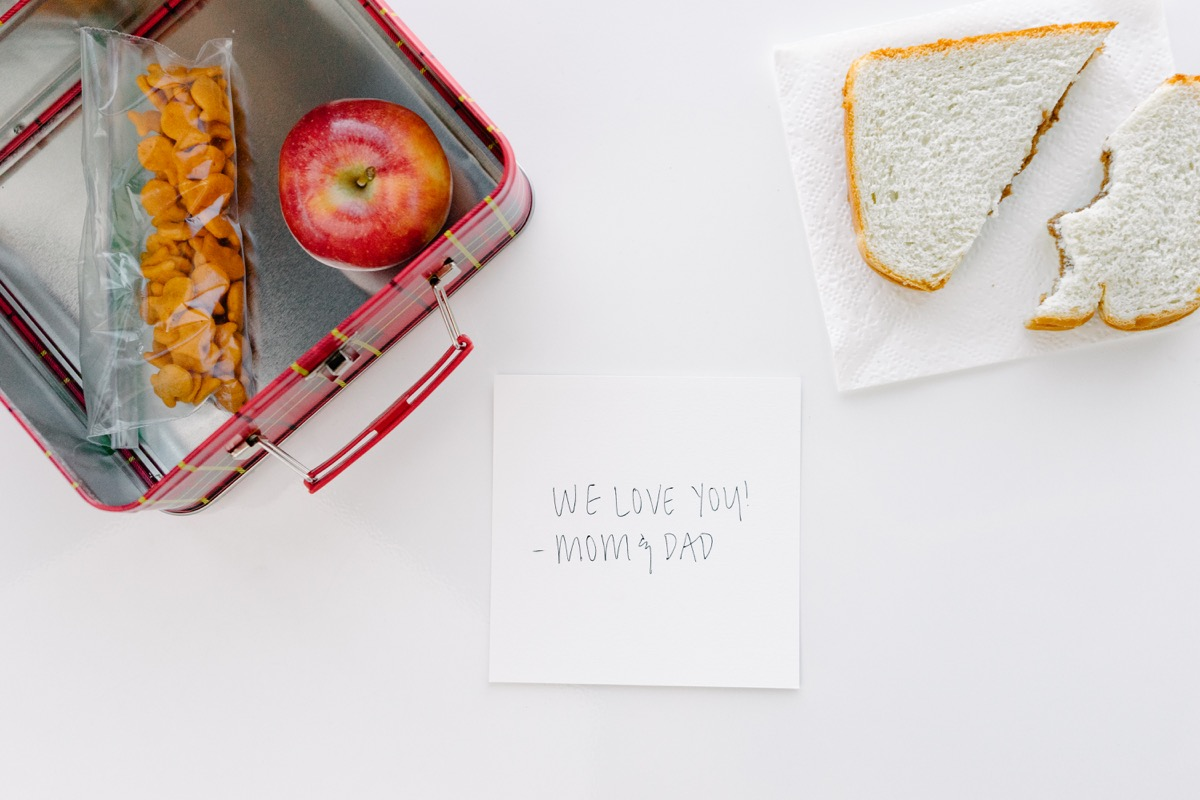 A square print in a lunch box with a note on the back from Mom and Dad