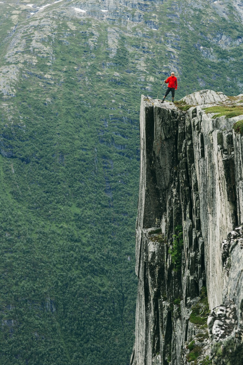 Man standing on cliff high above