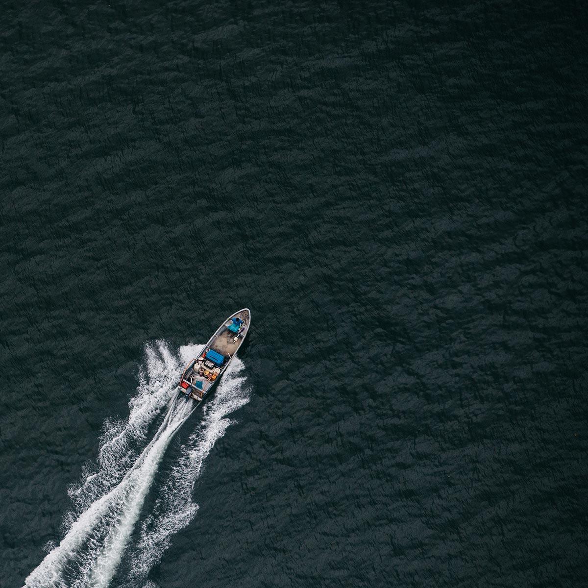 Speedboat cruising in open waters
