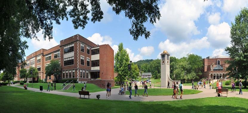 WVSU campus and clocker tower with students walking around.