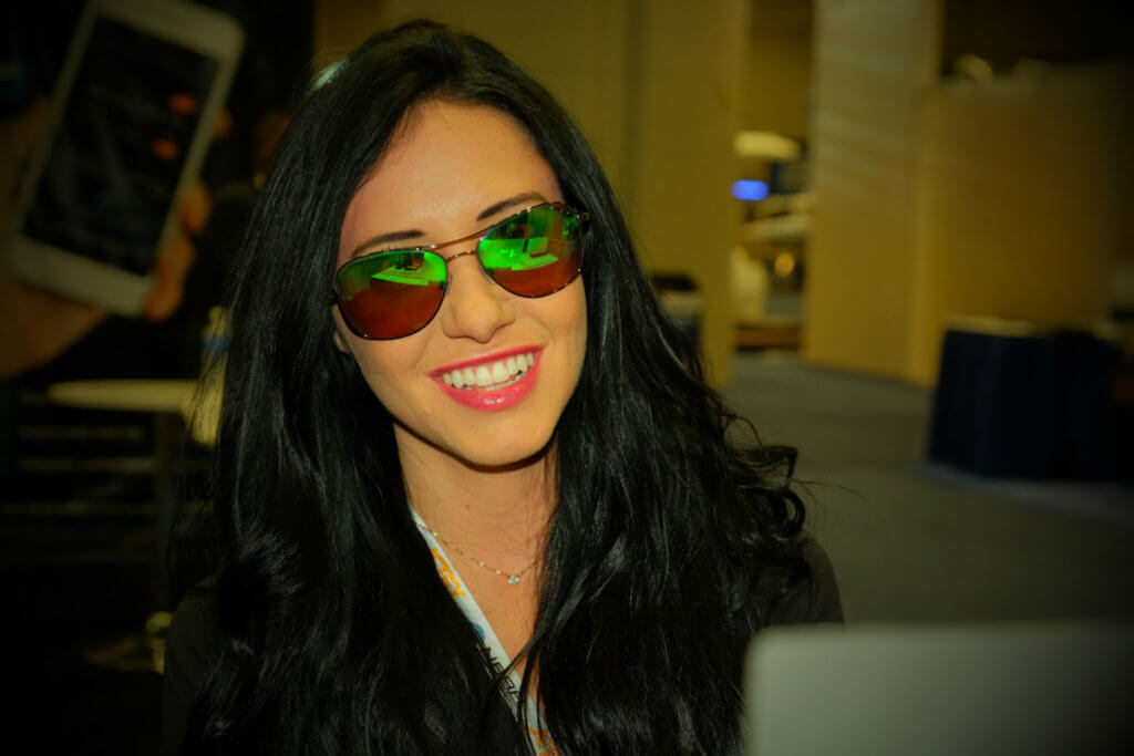 Tracy Maloney, sales coordinator for ST Laserstrike, models glasses that block out the majority of light from green and blue lasers, as well as infrared and ultraviolet light.