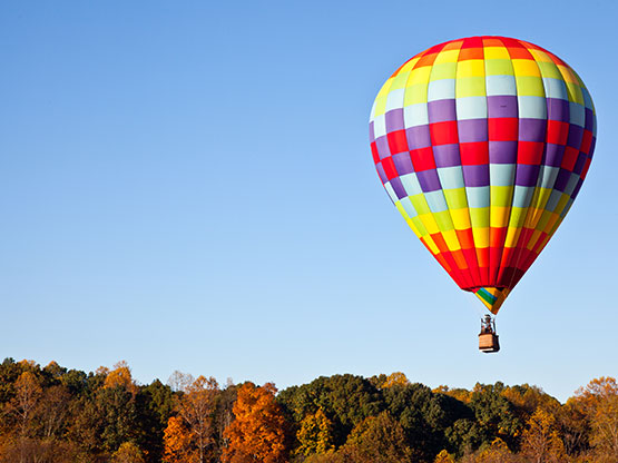 A hot air balloon flying high over our Spartanburg apartments