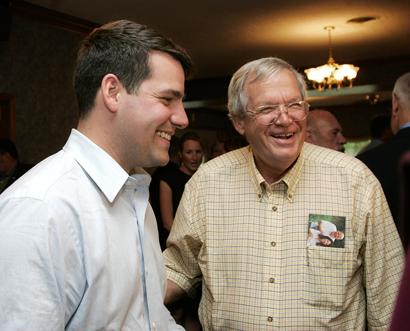 Ethan Hastert, left, laughs with his father, former U.S. Congressman and Speaker of the House, Dennis Hastert at a fundraising dinner on Friday evening in Sandwich. This dinner was the official fundraising kick-off for Ethan Hasterts Illinois 14th Congressional District campaign. Kevin Sherman/ksherman@dailyherald.com/©Daily Herald