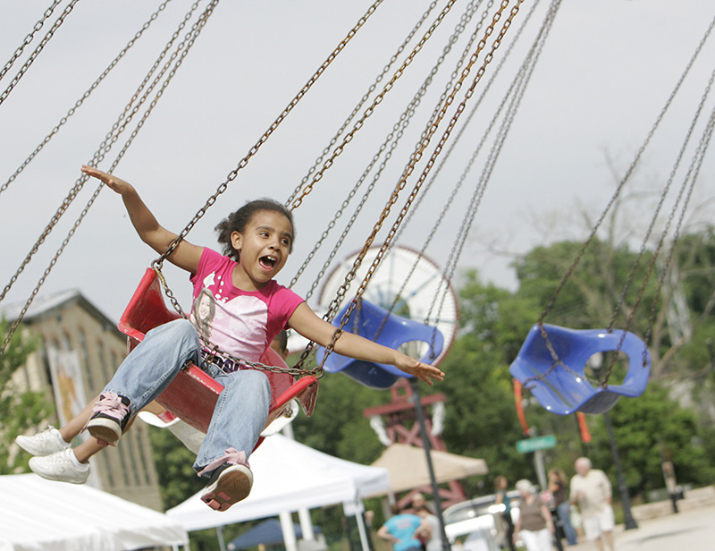 Tykeya Munger, 8, of Aurora enjoys a ride at the carnival during Batavias Windmill City Festival on Friday evening. Kevin Sherman/ksherman@dailyherald.com/©Daily Herald