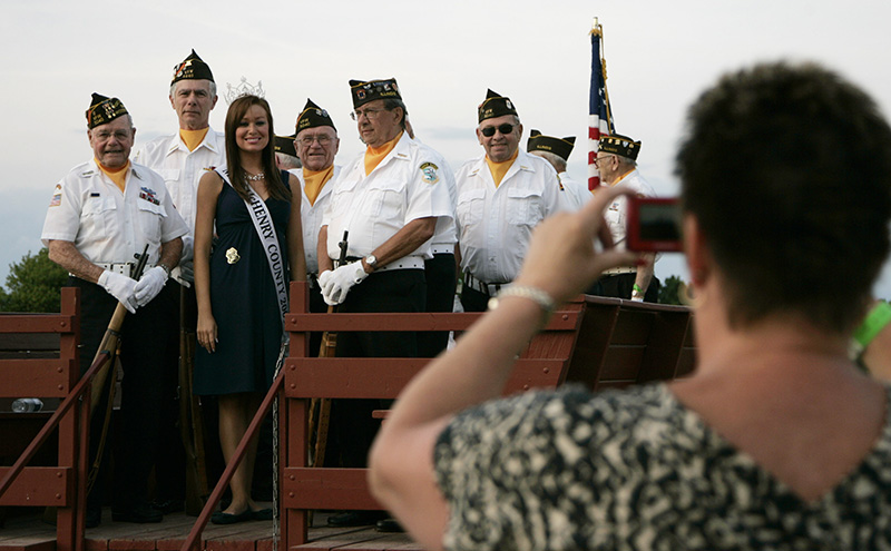 Miss McHnery County 2009 winner Hannah Smith poses with Woodstock VFW Post 5040 members during the McHenry County Fairs 21 Tractor Salute in Woodstock on Thursday evening. Kevin Sherman/ksherman@dailyherald.com/©Daily Herald
