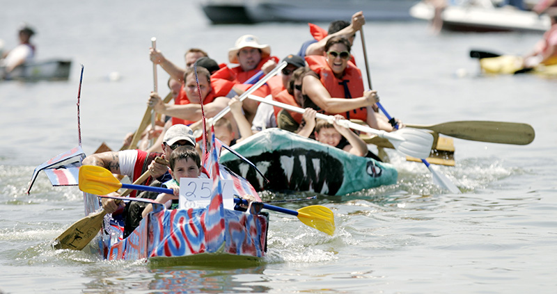 The Stimulus Package trails the Captain America in a close race during the eighth heat of the Americas Cardboard Cup Regatta at Main Beach in Crystal Lake on Saturday afternoon. Kevin Sherman/ksherman@dailyherald.com/©Daily Herald