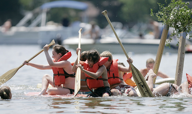 Crystal Lake Park District Summer Camp boat Teen Camps crew reacts as their boat begins to sink before finishing their race during the Americas Cardboard Cup Regatta at Main Beach in Crystal Lake on Saturday afternoon. Kevin Sherman/ksherman@dailyherald.com/©Daily Herald