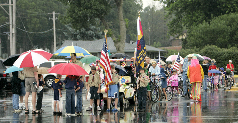 The Sugar Grove Fourth of July bike parade waits to get underway on a rainy Saturday afternoon. Kevin Sherman/ksherman@dailyherald.com/©Daily Herald