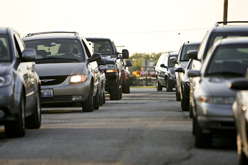 Cars line up early for a recent showing at the McHenry Outdoor Theatre. On a busy night, more than three thousand adults and children will attend the theaters two movies. KEVIN SHERMAN/ksherman@dailyherald.com/©Daily Herald