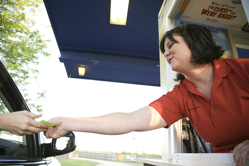 Sarah Jackowiak hands out tickets at a recent showing at the McHenry Outdoor Theatre. KEVIN SHERMAN/ksherman@dailyherald.com/©Daily Herald