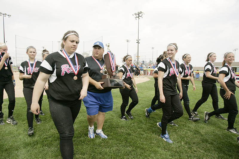 Burlington Central winning pitcher Mackenzie Scott, left, walks with Coach Scot Sutherland who is carrying the teams third place trophy after their 3-1 win over Glenbard South in the Class 3A state softball tournament on Saturday morning at the Eastside Centre fields in East Peoria. Kevin Sherman/ksherman@dailyherald.com/©Daily Herald