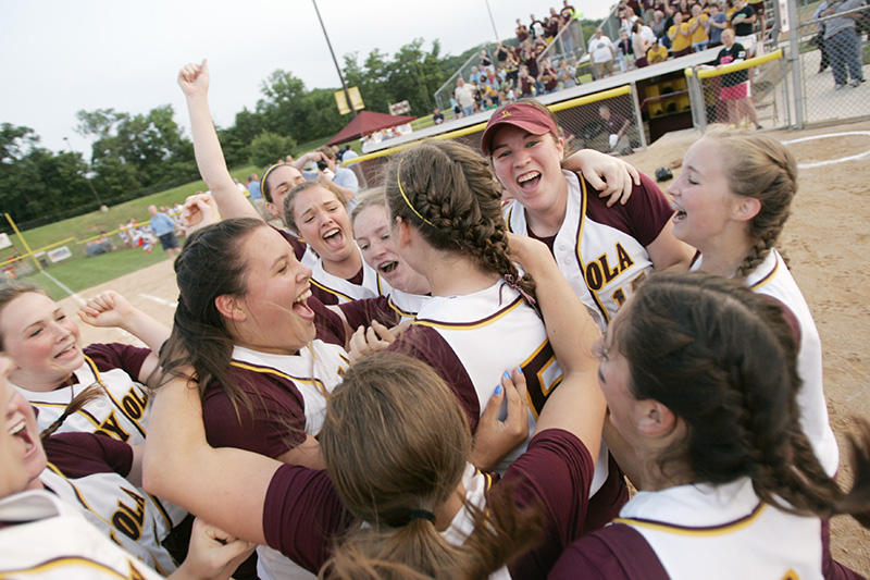 Loyolas pitcher Devin Miller is surrounded by teammates at home plate after their 2-0 victory over Edwardsville to claim the Class 4A state championship on Saturday evening at the EastSide Centre fields in East Peoria. Kevin Sherman/ksherman@dailyherald.com/©Daily Herald