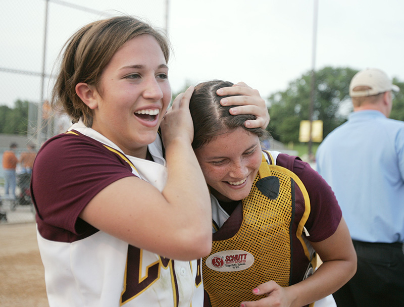 Loyolas Maggie Mullen, left, celebrates with catcher Teresa Aguilar, right, after their 2-0 victory over Edwardsville to claim the Class 4A state championship on Saturday evening at the EastSide Centre fields in East Peoria. Kevin Sherman/ksherman@dailyherald.com/©Daily Herald