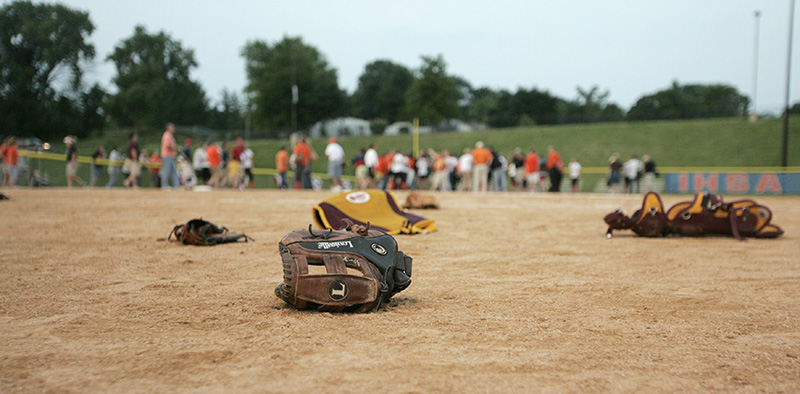 Loyola Ramblers gear lays on the field near home plate after their state championship victory over Edwardsville on Saturday evening at the EastSide Centre fields in East Peoria. Kevin Sherman/ksherman@dailyherald.com/©Daily Herald