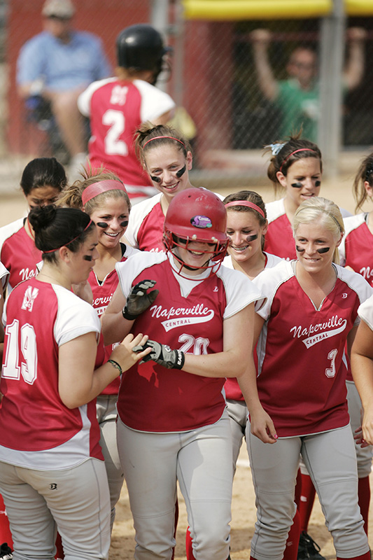 Naperville Central senior Stephanie Lynch is greeted by teammates after a one-out home run to right field in their Class 4A third place game against Fremd on Saturday afternoon at the EastSide Centre fields in East Peoria. Kevin Sherman/ksherman@dailyherald.com/©Daily Herald