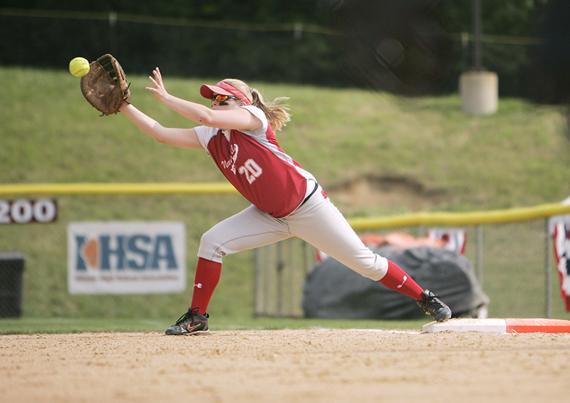 Naperville Central first baseman Stephanie Lynch reaches for the ball to complete a play during the second inning in their Class 4A third place game against Fremd on Saturday afternoon at the EastSide Centre fields in East Peoria. Kevin Sherman/ksherman@dailyherald.com/©Daily Herald
