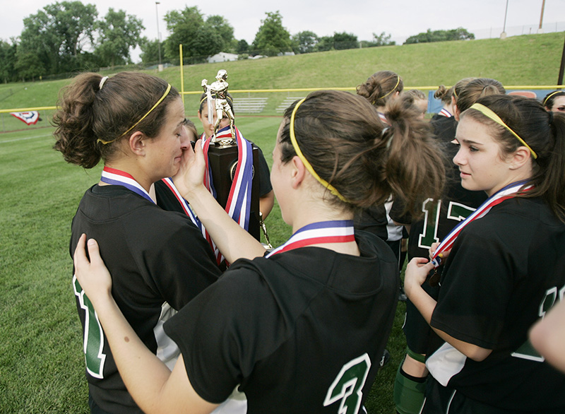 Fremd senior Jessica Tackett reacts reacts after receiving the teams third place trophy from their 3-2 win during their Class 4A third place game against Naperville Central on Saturday afternoon at the EastSide Centre fields in East Peoria. Kevin Sherman/ksherman@dailyherald.com/©Daily Herald