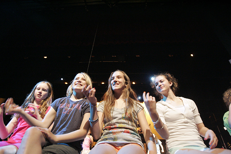 Arreyellen Salyards, from the left, Abigail Steffen, Emma Sirridge and Amelia Gill sit on the front of the stage at Elgin Community Colleges Blizzard Theatre during their rehearsal of the Legends of Music performance on Monday night. The production is being performed by the Fox Valley Theatre Company and Childrens Theatre of Elgin with performances starting this Friday. Kevin Sherman/ksherman@dailyherald.com/©Daily Herald