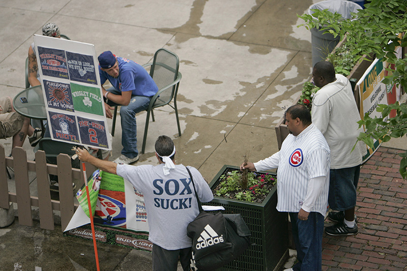 Vendors off of Waveland Avenue sell T-Shirts before the Cubs vs. Sox game on Wednesday afternoon near Wrigley Field. Kevin Sherman/ksherman@dailyherald.com/©Daily Herald