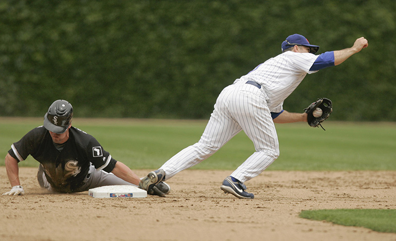 Scott Podsednik of the White Sox successfully steals second with the Cubs Aaron Miles defending during the third inning of their game on Wednesday afternoon at Wrigley Field. Kevin Sherman/ksherman@dailyherald.com/©Daily Herald