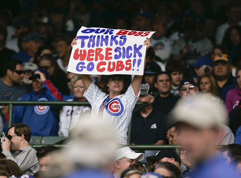 A Cubs fan raises a sign over her head during the Crosstown Classic between the Cubs and White Sox on Wednesday afternoon at Wrigley Field. Kevin Sherman/ksherman@dailyherald.com/©Daily Herald
