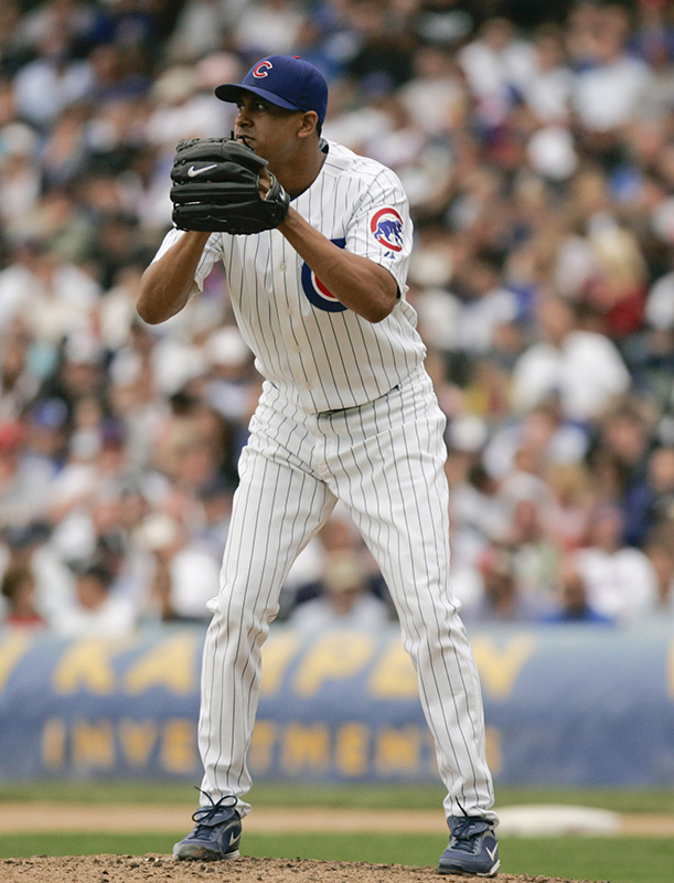 Cubs relief pitcher Angel Guzman checks the runners while pitching in the seventh inning of their game against the White Sox on Wednesday afternoon at Wrigley Field. Kevin Sherman/ksherman@dailyherald.com/©Daily Herald