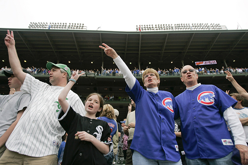 White Sox fans and Cubs fans sing the Seventh Inning Stretch together during the Crosstown Classic on Wednesday afternoon at Wrigley Field. Kevin Sherman/ksherman@dailyherald.com/©Daily Herald