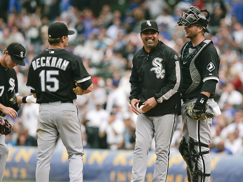 White Sox manager Ozzie Guillen shares a laugh with his infielders during the eighth inning of their game against the Cubs on Wednesday afternoon at Wrigley Field. Kevin Sherman/ksherman@dailyherald.com/©Daily Herald