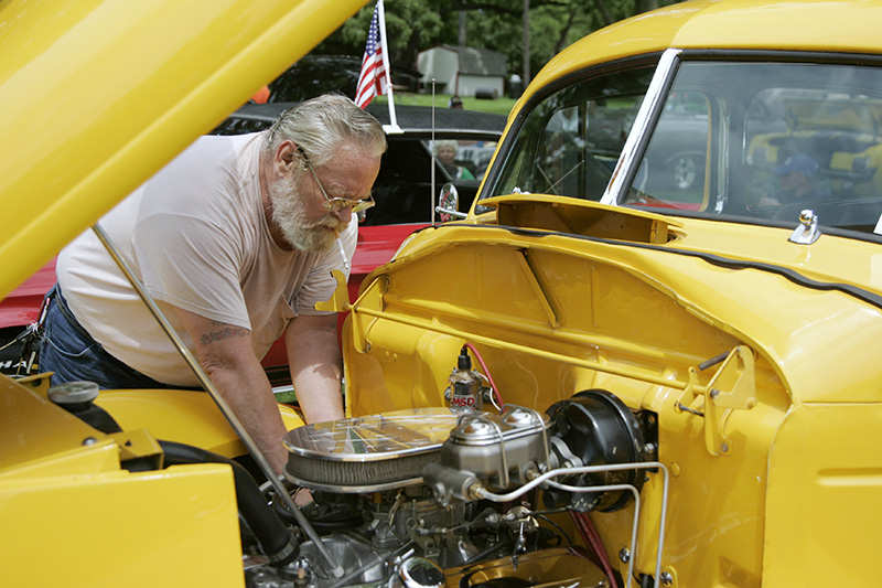 Skip Bannon of Morris checks the oil in his 1939 Hudson during the Old Gold Cruisers Fathers Day Car show in Batavia on Sunday afternoon. Kevin Sherman/ksherman@dailyherald.com/©Daily Herald