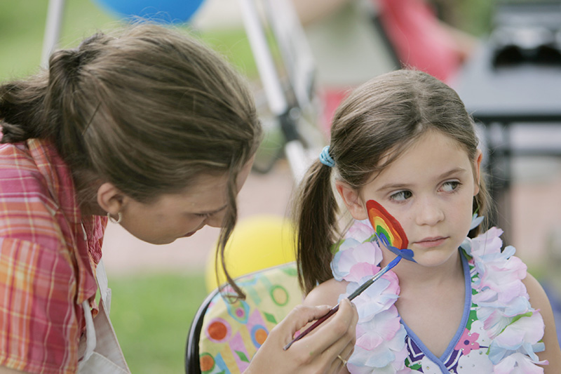 Marisa Lewis of Geneva paints a rainbow on Isabella Madlnia of Springfield during Genevas Midsommar Swedish Days Festival on Thursday afternoon. Kevin Sherman/ksherman@dailyherald.com/©Daily Herald