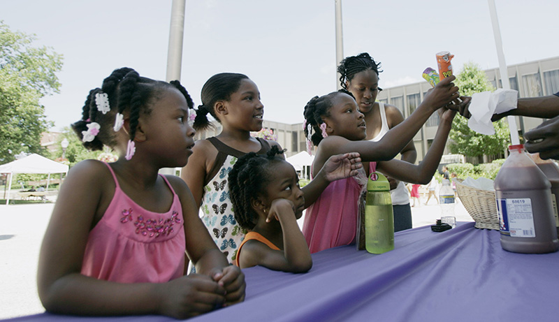 Lakisha, from left, Isis, Alera, Betty and Pamela Brown of Elgin buy ice cream during the Juneteenth Festival in Downtown Elgin on Saturday afternoon. Kevin Sherman/ksherman@dailyherald.com/©Daily Herald