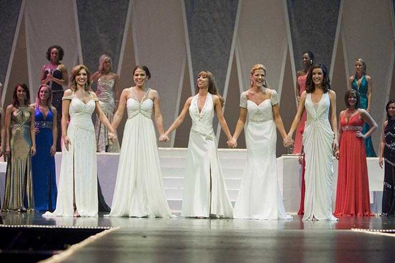 The top five contestants for the Miss Illinois 2009 pageant, from the left, Jamie Johnson, Rachel Brock, Corina Harwood, Chelsea Fahey and Erin OConnor wait for the winner to be announced on Saturday night at the Norris Cultural Arts Center in St. Charles. Kevin Sherman/ksherman@dailyherald.com/©Daily Herald