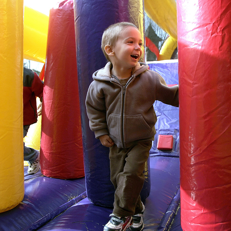 Zach Jones, 2, from Algonquin runs around inside of an inflatable obstacle course during the Old Time Country Harvest Day in Algonquin on Saturday morning.  Kevin Sherman/ksherman@dailyherald.com/© Daily Herald