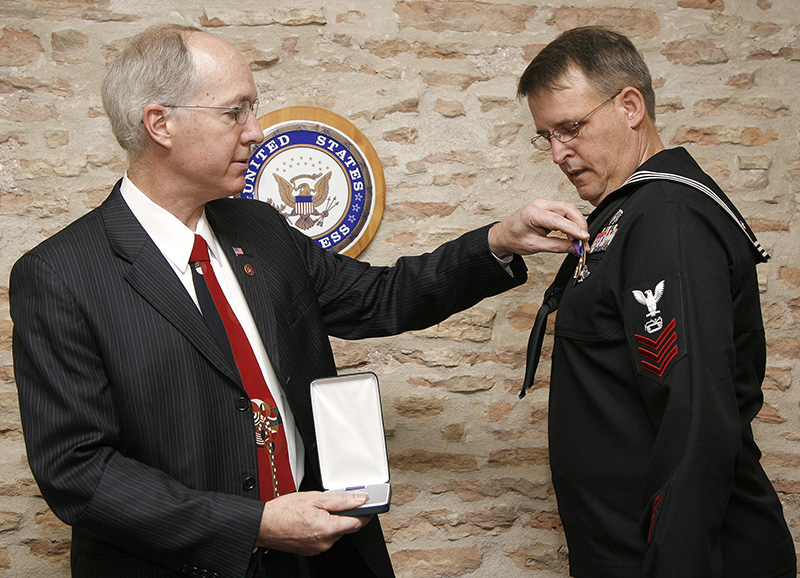 United States Congressman Bill Foster presents Equipment Operator First Class Walter R. Ripley Jr., United States Navy with a Purple Heart medal after being injured during combat operations in Iraq at the Congressmans office in Batavia on Saturday afternoon. Kevin Sherman/ksherman@dailyherald.com/© Daily Herald