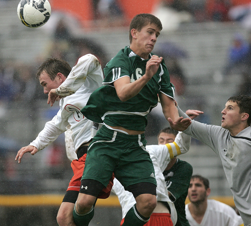St. Charles Easts Alex Cairns collides with Waubonsies Jason OBrien during the final moments of their 2-1 loss on Saturday afternoon. Kevin Sherman/ksherman@dailyherald.com/© Daily Herald